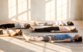 Group of people practicing yoga in Bermondsey